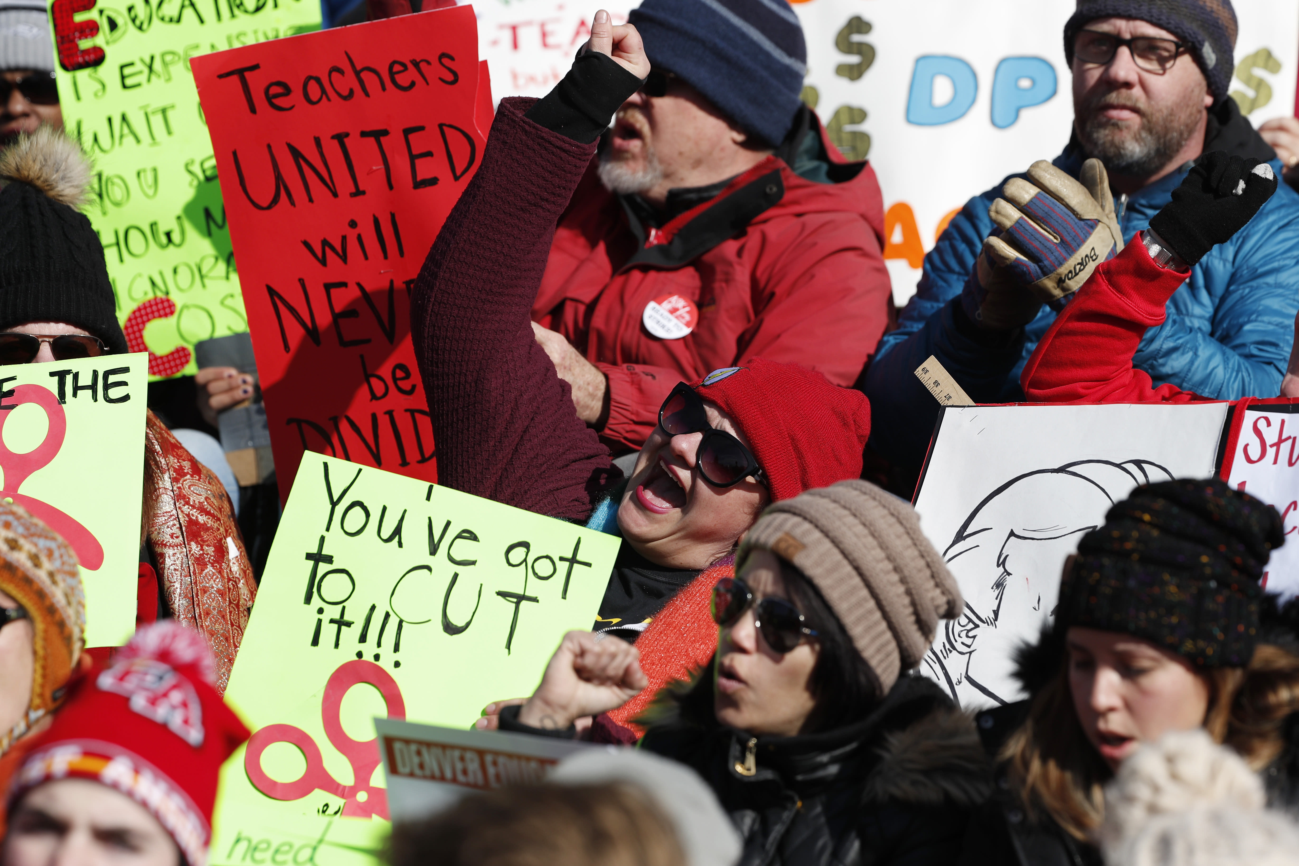 Teachers chant in support during a strike rally on the west steps of the State Capitol Monday, Feb. 11, 2019, in Denver. The strike is the first for teachers in Denver since 1994 and centers on base pay. (AP Photo/David Zalubowski)
