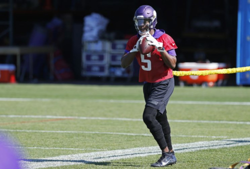 Teddy Bridgewater, shown here in a June minicamp, is still working back from a terrible leg injury. (AP)