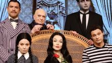 Kelly Ripa and Mark Consuelos Transform into Morticia and Gomez Addams — with Ryan Seacrest as Pugsley