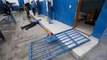 Officials: 100 mostly barefoot inmates escape Haiti lockup