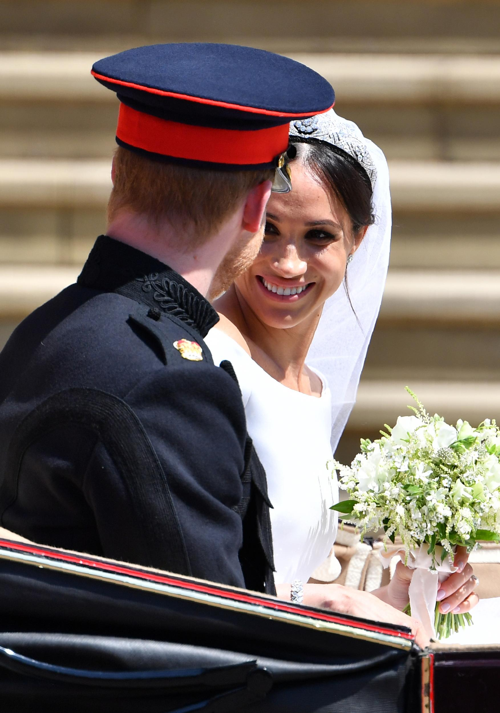 Prince Harry and Meghan Markle get into the Ascot Landau Carriage as they leave St. George's Chapel in Windsor Castle after their wedding ceremony.