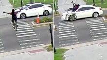 Terrifying moment cyclist is mowed down by car in hit-and-run