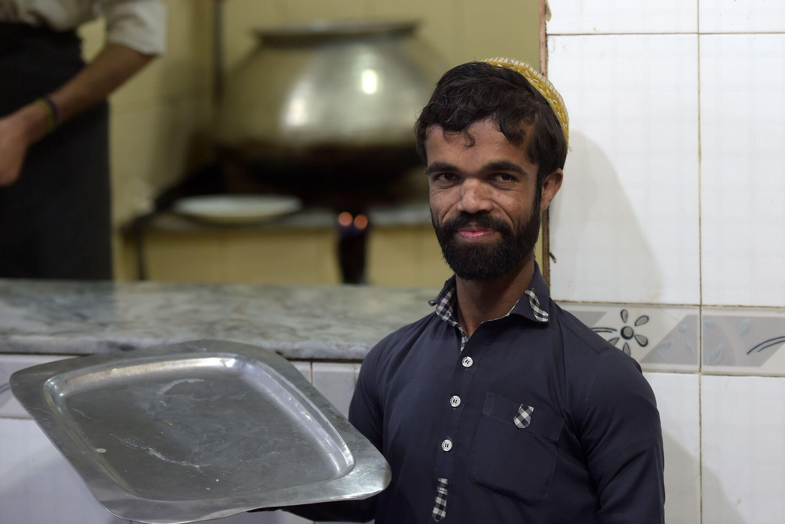 In this picture taken on February 22, 2019, Rozi Khan, a 25-year-old Pakistani waiter who resembles US actor Peter Dinklage, looks on at Dilbar Hotel in Rawalpindi. - Rozi Khan had never heard of the Game of Thrones -- or its hugely popular character Tyrion Lannister -- until his striking resemblance to the dwarf anti-hero got heads turning at home. (Photo by AAMIR QURESHI / AFP) / To go with PAKISTAN-LIFESTYLE-TELEVISION-ENTERTAINMENT        (Photo credit should read AAMIR QURESHI/AFP/Getty Images)