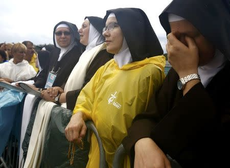 Nuns wait for Pope Francis farewell ceremony at Balice airport near Krakow, Poland July 31, 2016. REUTERS/Kacper Pempel