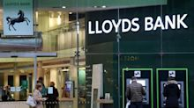 Lloyds bank reports loss after setting aside £2.4bn