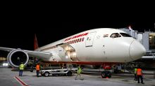 Flight attendant falls out of plane while preparing for departure, sustaining injuries to her legs after hitting tarmac