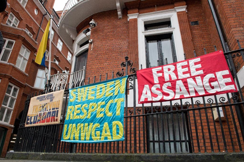 Banners supporting WikiLeaks founder Julian Assange outside the Ecuadoran embassy in London where he has been holed up since 2012 (AFP Photo/JUSTIN TALLIS)