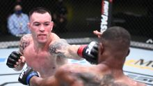 Covington gets odd finish in Woodley rematch