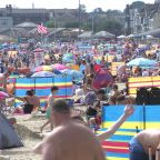 Britons crowd beaches despite COVID on another scorching day