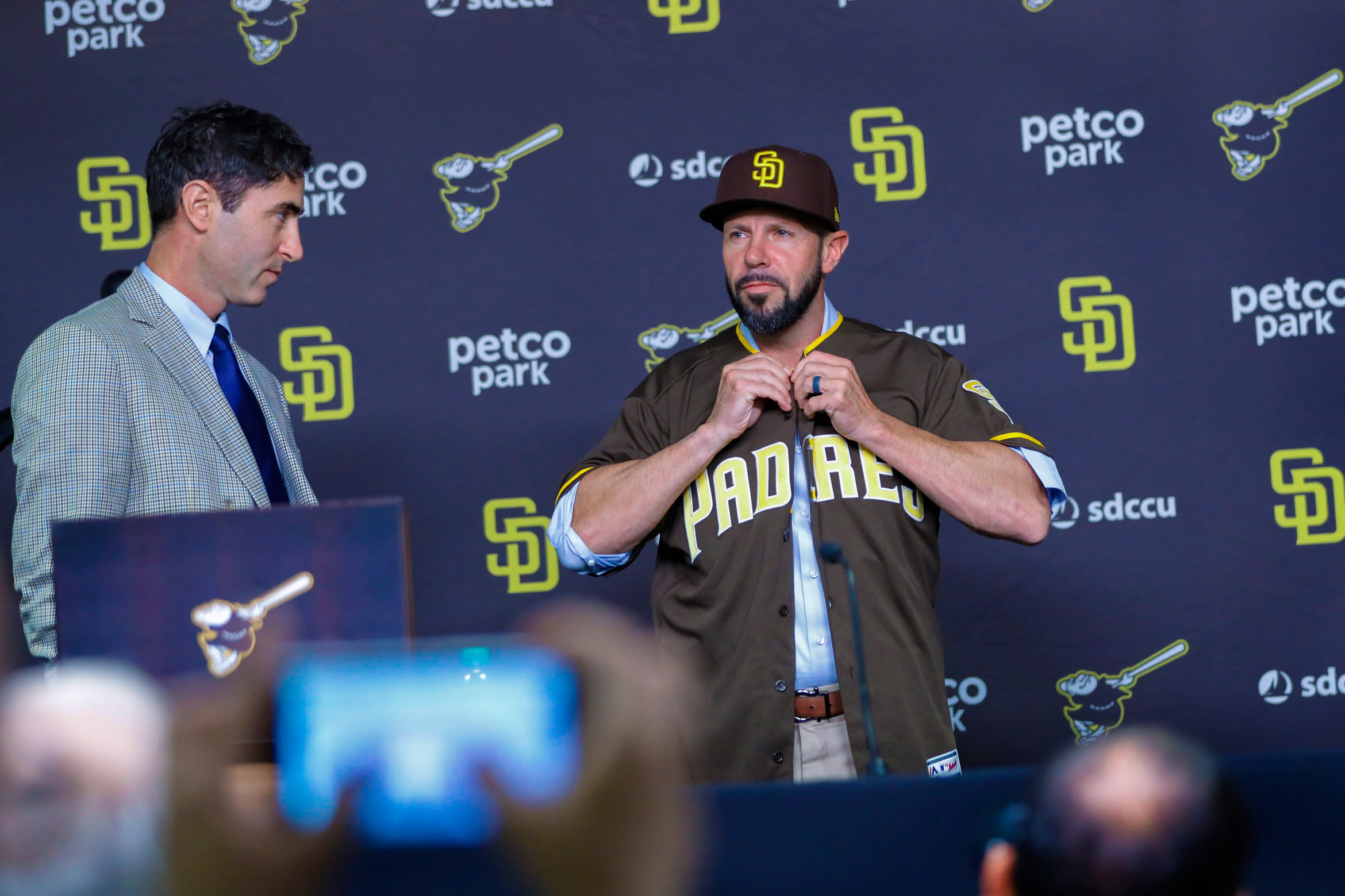 San Diego Padres general manager A.J. Preller, left, introduces the baseball team's new manager, Jayce Tingler, during a news conference Friday, Oct. 31, 2019, in San Diego. (Nelvin C. Cepeda/The San Diego Union-Tribune via AP)