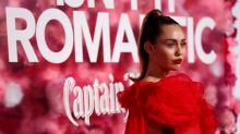 Miley Cyrus stands in for sick Liam Hemsworth at 'Isn't It Romantic' premiere