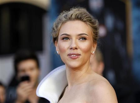 """Johansson poses at the premiere of the movie """"Iron Man 2"""" at El Capitan theatre in Hollywood"""