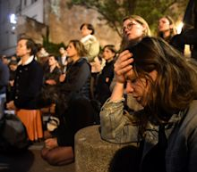 'I don't have words for this': Devastated Parisians watch in shock as Notre Dame Cathedral burns
