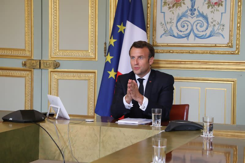 French President Emmanuel Macron takes part in a video conference with World Health Organization (WHO) general director Tedros Adhanom Ghebreyesus in Paris