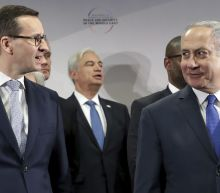 The Latest: US Jewish group asks Poland, Israel to stay calm