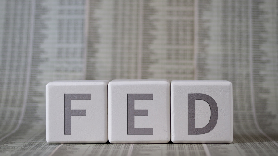 Fed cuts rates, gives mixed signals on future policy