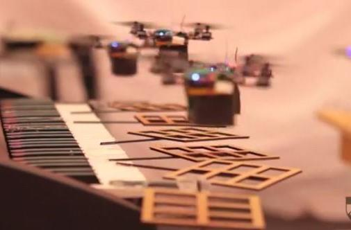 Mini quadrotors play Bond, James Bond (video)