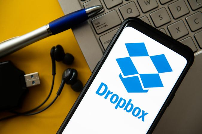 In this photo illustration a Dropbox logo seen displayed on...