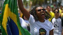 Gays, blacks still voting for Brazil's Bolsonaro despite rhetoric