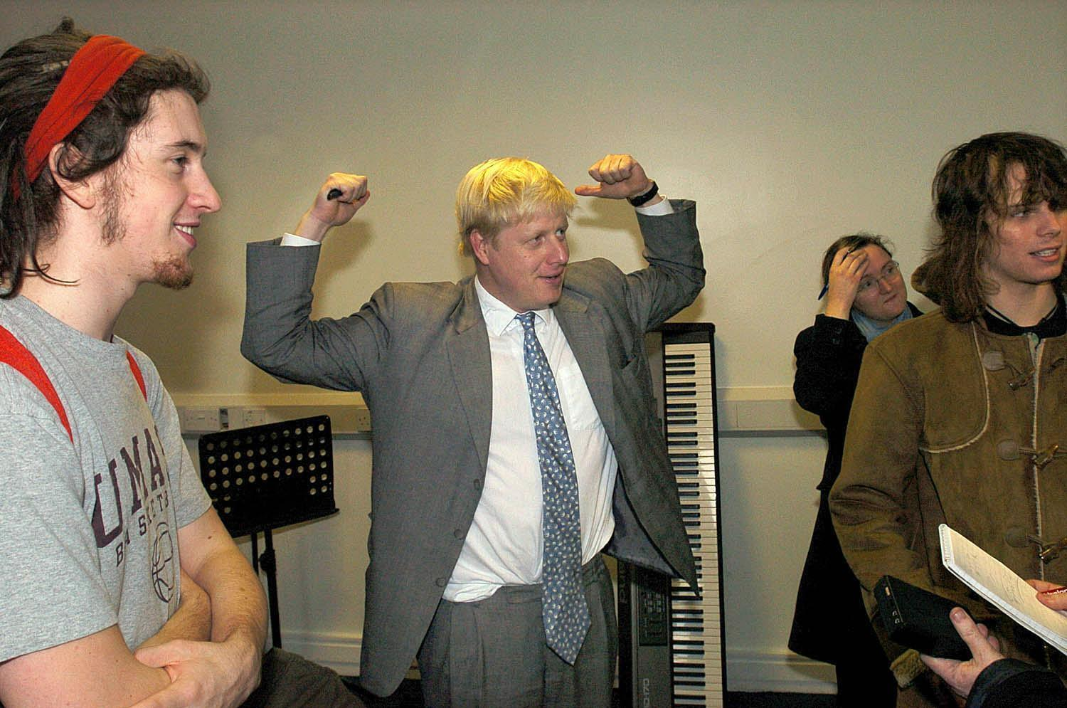 """Boris Johnson MP (centre) and editor of the Spectator at the Liverpool Institute for Performing Arts during a visit to the city to apologise for remarks made in his magazine about beheaded hostage Ken Bigley and the Hillsborough tragedy. But council leaders called on the people of Liverpool to ignore the """"Boris Johnson show"""". The Tory MP for Henley created a storm of protest after the publication of a leader written in the Spectator, which suggested Liverpudlians were """"hooked on grief""""."""