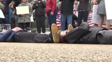 Students stage 'lie-in' at White House to protest against gun violence