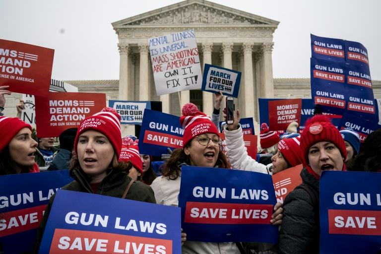 Gun safety advocates rally in front of the US Supreme Court (AFP Photo/Drew Angerer)