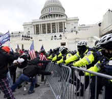 Connecticut man charged in attack on police officer who was trapped in doors at Capitol riot