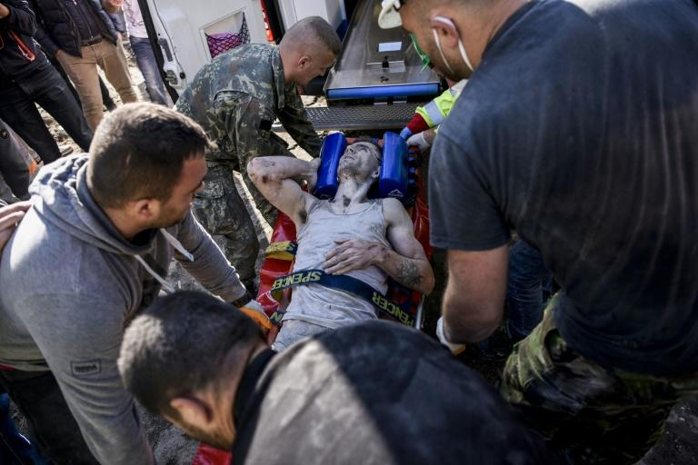 Many people were believed still trapped in the rubble (AFP Photo/Armend NIMANI)