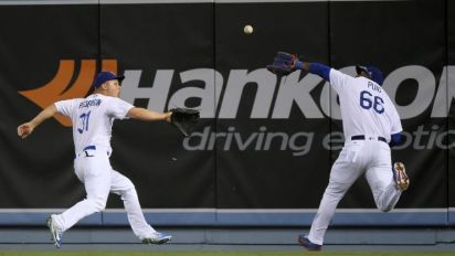 Yasiel Puig, Joc Pederson knock each other over in scary outfield collision