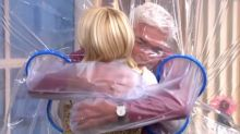 'I don't want to let go!' Holly Willoughby and Phillip Schofield hug through plastic sheet as they reunite on This Morning