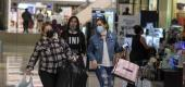 Black Friday shoppers wearing face masks. (Ringo H.W. Chiu/AP)