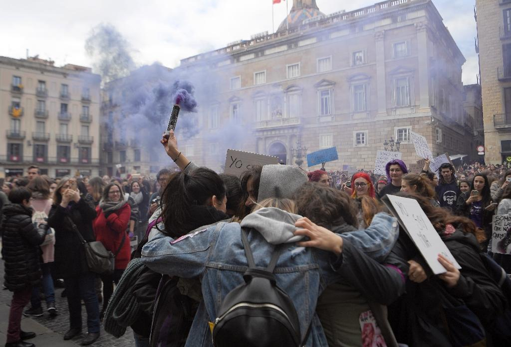 Demonstrators gathered at Sant Jaume square in Barcelona during a one-day strike to defend women's rights on International Women's Day (AFP Photo/LLUIS GENE)