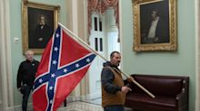 A man accused of storming the Capitol with a giant Confederate flag will get to go on a family road trip while awaiting trial