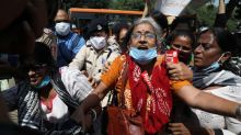 Protesters clash with police in India after late night cremation of gang rape victim