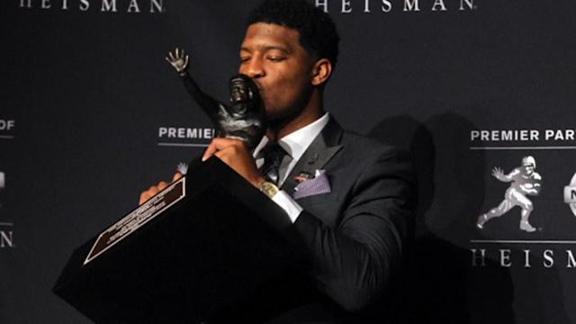 College football player in rape investigation wins Heisman