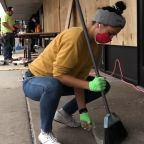 Volunteers on the West Side clean up looted businesses