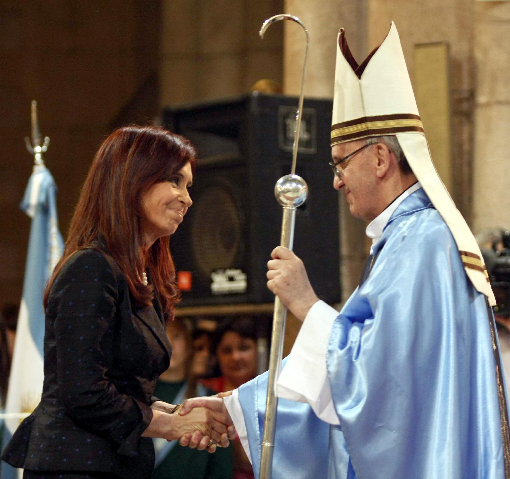 FILE - In this Dec. 12, 2008 file photo, Argentina's President Cristina Fernandez, left, shakes hands with Buenos Aires' archbishop Jorge Mario Bergoglio in Lujan, Argentina. Bergoglio, who chose the name of Francis, was chosen as the 266th pontiff of the Roman Catholic Church on March 13, 2013. Pope Francis has honed his leadership skills in one of the most difficult classrooms on the planet: Argentina, where politics has long been a blood sport practiced only by the brave. (AP Photo/DyN, File)