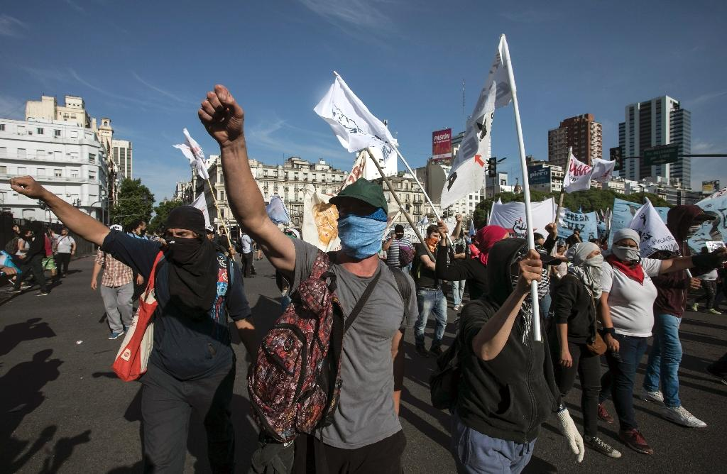 Tens of thousands of protesters rallied in Buenos Aires to denounce the government for spending millions on the G20 summit while the public endures economic hardship (AFP Photo/ALBERTO RAGGIO)