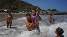After 7 Months, It's Back To The Beach For Some Venezuelans