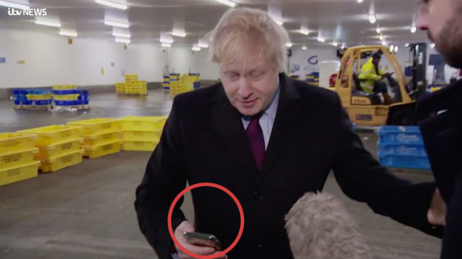 PM grabs phone with photo of boy on hospital floor