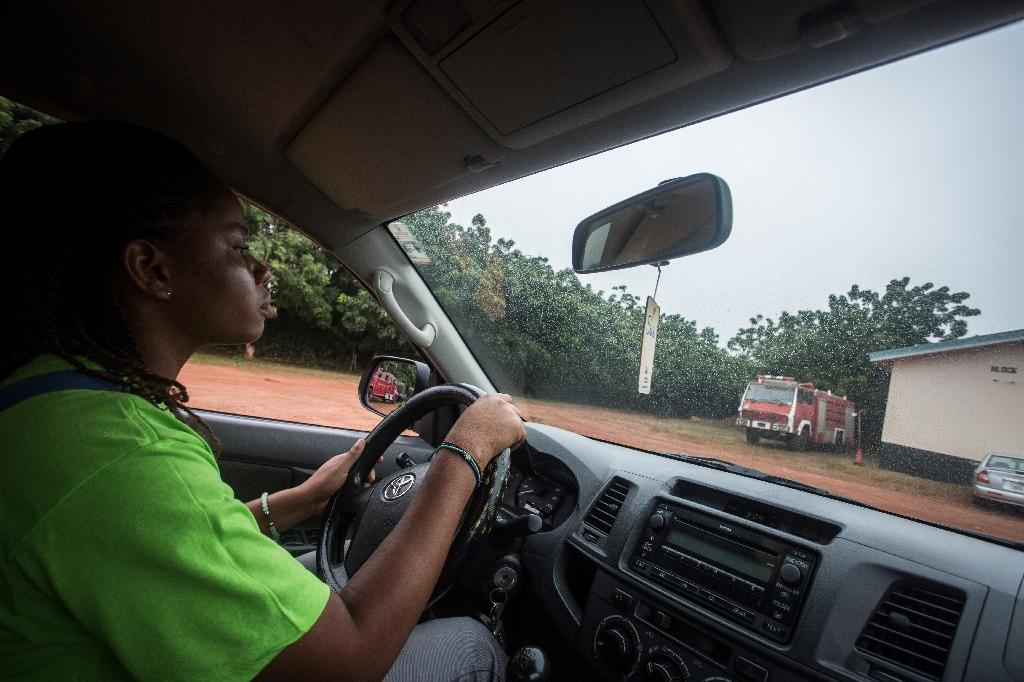 Faith Lawson learns how to drive during a lesson organised by the Ghanaian charity Network of Women in Growth which aims to draw women into more lucrative professions (AFP Photo/Ruth McDowall)