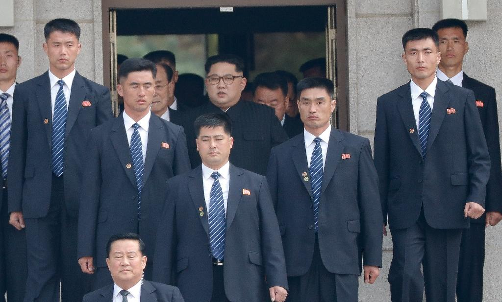 Is that a gun in your pocket? North Korean leader Kim Jong Un is always surrounded by tight security, and his bodyguards are chosen for their fitness, marksmanship and martial arts skills (AFP Photo/Korea Summit Press Pool)