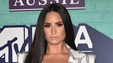 Demi Lovato Skips A Shirt Underneath Her Suit At The MTV EMAs