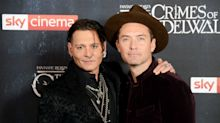 Fantastic Beasts star Jude Law discusses Johnny Depp's 'unusual' sacking from the franchise