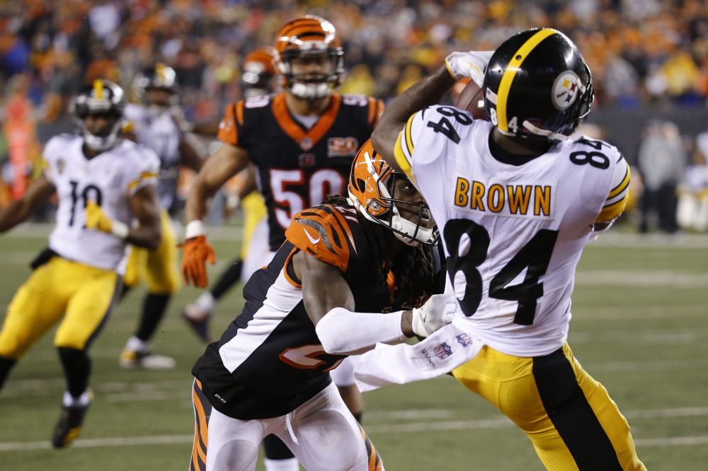 Steelers wideout Antonio Brown caught a touchdown pass and paid for it as he received a head shot from George Iloka (not pictured). The Bengal was suspended for the blow on Tuesday. (AP)