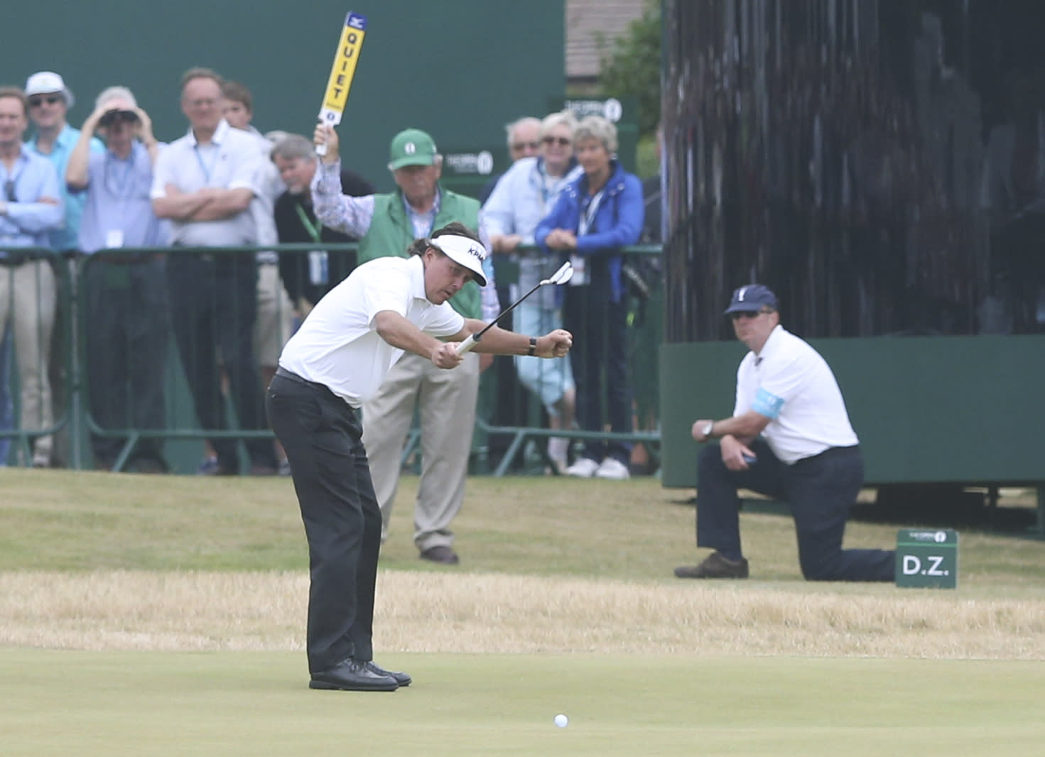 Phil Mickelson of the United States gestures after making his final putt on the 18th green during the final round of the British Open Golf Championship at Muirfield, Scotland, Sunday July 21, 2013. (AP Photo/Scott Heppell)