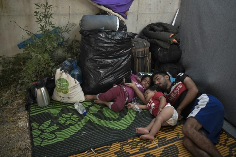 Many migrants camped on the roadside, some hesitant or outright refusing to go into the new camp