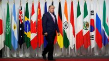 Asian markets slip as G-20 meeting kicks off in Japan