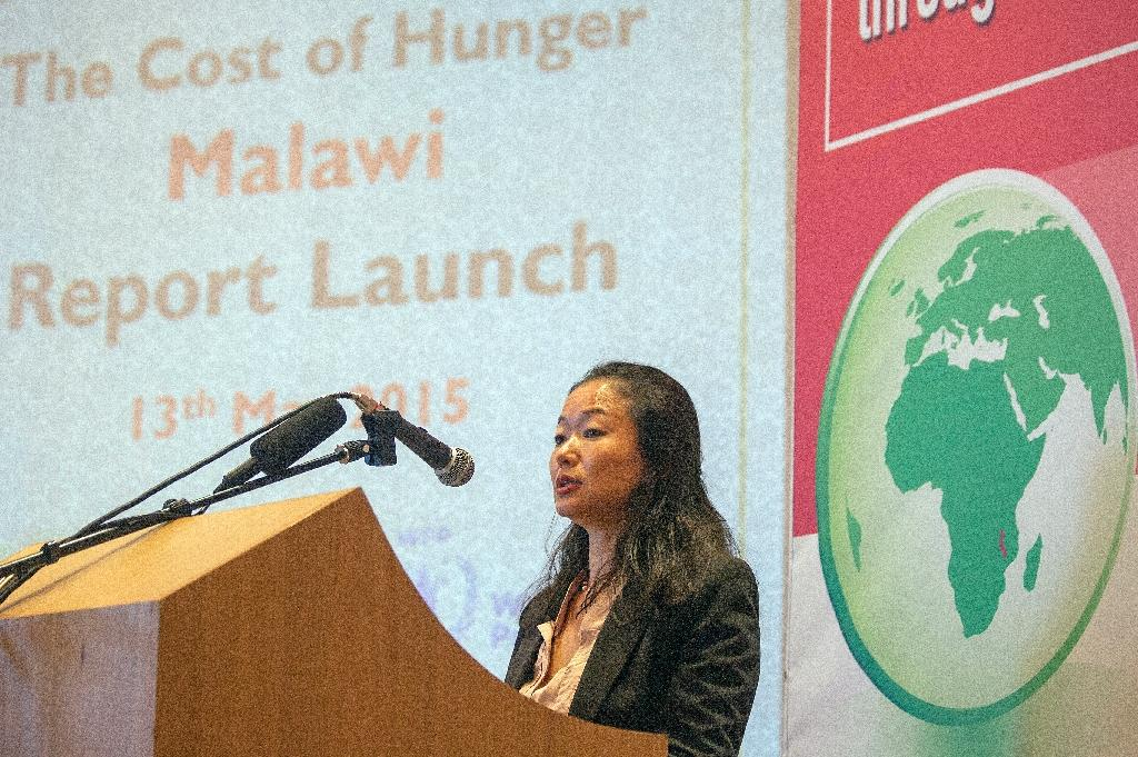 "World Food Program country representative in Malawi, Coco Ushiyama, makes remarks on May 13, 2015, during the official launch of the report ""Cost of Hunger in Malawi: The Social and Economic Impact of Child Undernutrition"" in Lilongwe (AFP Photo/Amos Gumulira)"