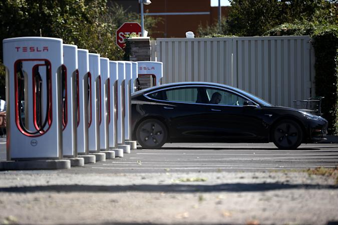 PETALUMA, CALIFORNIA - SEPTEMBER 23: A Tesla car sits parked at a Tesla Supercharger on September 23, 2020 in Petaluma, California. California Gov. Gavin Newsom signed an executive order directing the California Air Resources Board to establish regulations that would require all new cars and passenger trucks sold in the state to be zero-emission vehicles by 2035. Sales of internal combustion engines would be banned in the state after 2035. (Photo by Justin Sullivan/Getty Images)